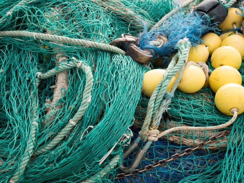Fisknät med gula floaters arkivfoto