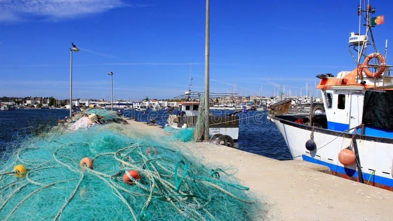 Fisknät- och fiskehamn royaltyfri foto