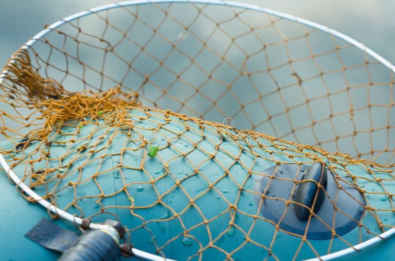 Fisknät på en fartygnärbildbakgrund royaltyfri bild