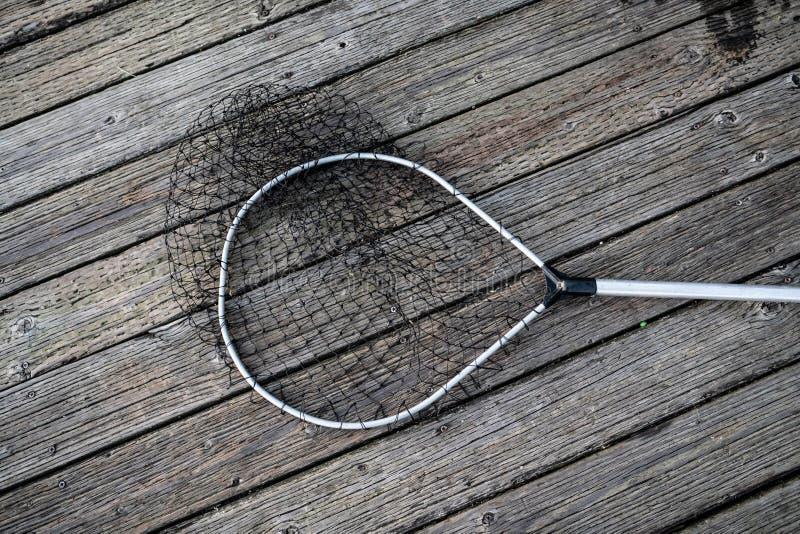 Fisknät på träpir arkivfoto