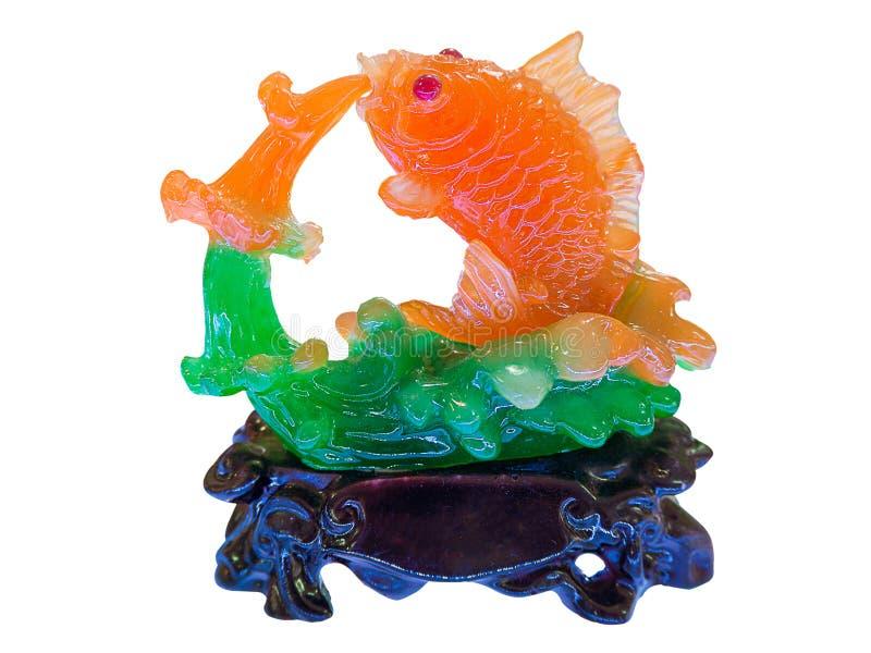 Fiskstatyett som göras av jade royaltyfri fotografi