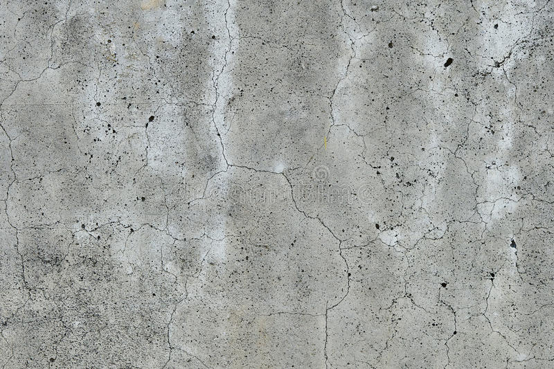 Fissured concrete wall gray stock image