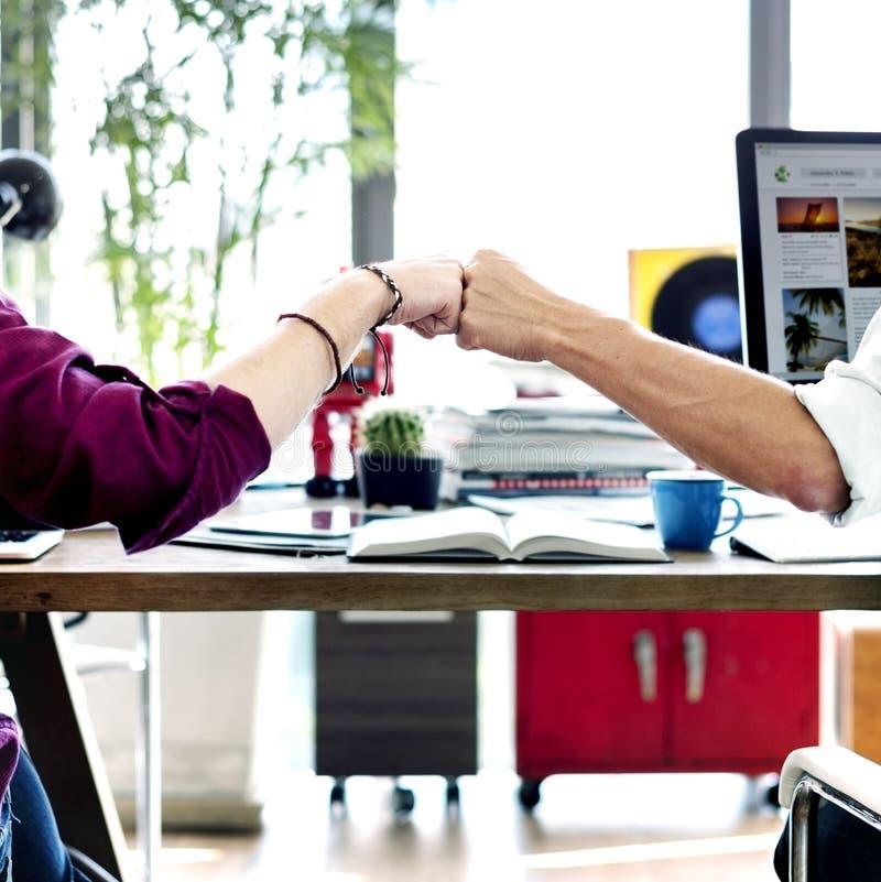 Fist Bump Corporate Colleagues Teamwork Office Concept stock photo