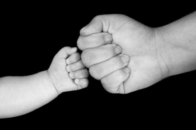 Fist bump. Is a gesture similar in meaning to a handshake or high five. A  can also be a symbol of giving respect royalty free stock photo