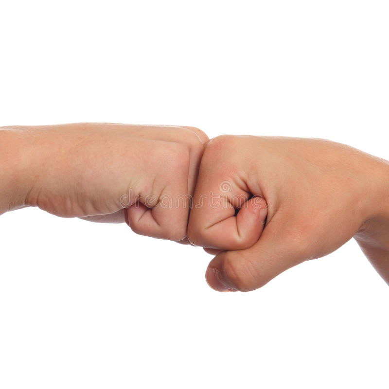 Fist greeting. A couple of fists greeting each other stock photos