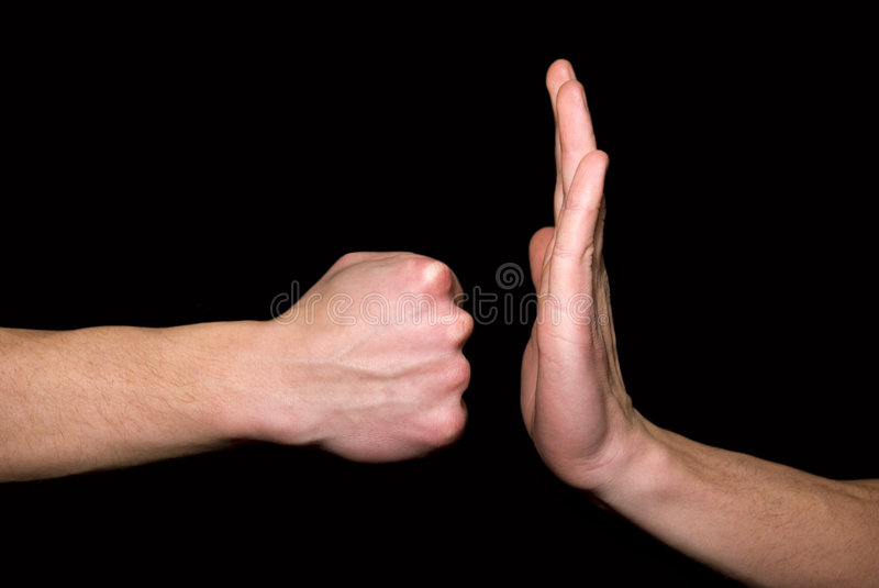 Fist on hand. Stroke by a fist in a hand on a black background royalty free stock image