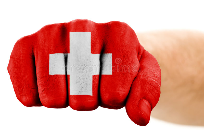 Fist with swiss flag. Isolated on white stock images