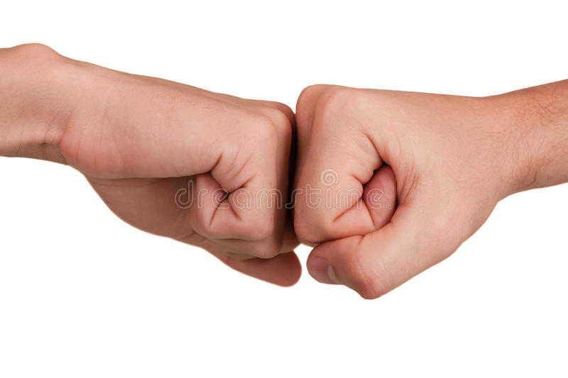 Fist to fist. Stroke by a fist in a fist on a white background royalty free stock image