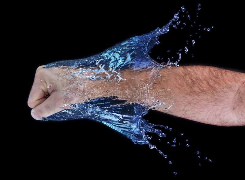 Fist through water royalty free stock photos