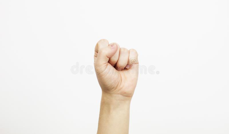 Fist on white, hand with fist above on white background,selective focus. Fist on white, hand with fist above on white background , selective focus royalty free stock images