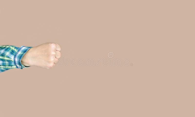 Fist of a woman throwing a punch stock photography