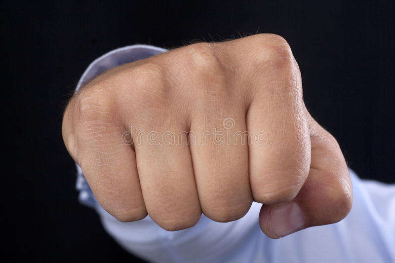 Fist in your face. Fist in your middle face stock image