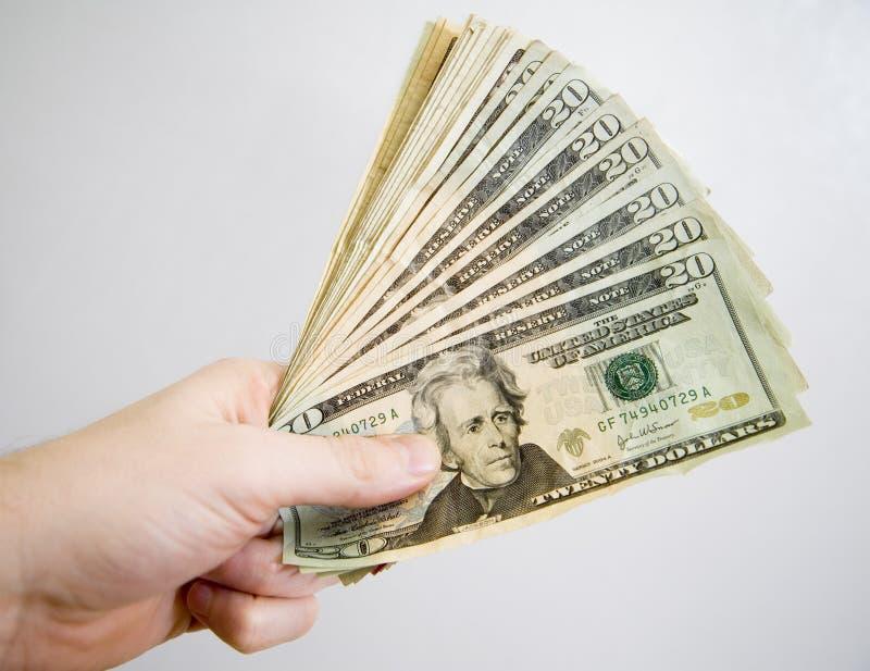 Fistful de efectivo imagen de archivo libre de regalías