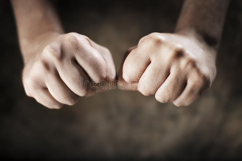 Fists. Man clenching his hands into fists royalty free stock photo