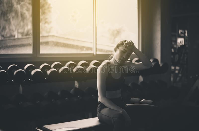 Fit asian woman tired and relax after the training session,Female taking a break after exercise and workout,Concept healthy and li. Festyle,Black and white toned stock photography
