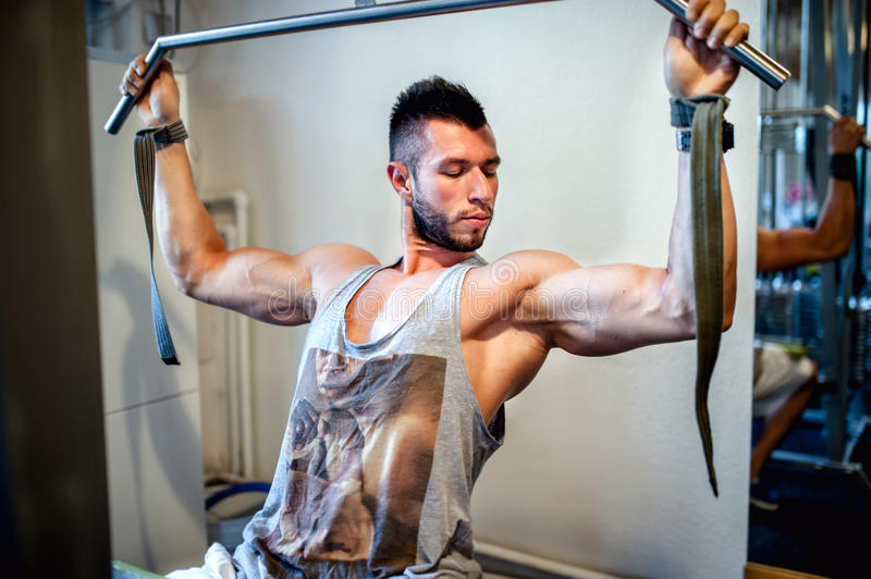Fit, athletic man working out in the gym stock photography
