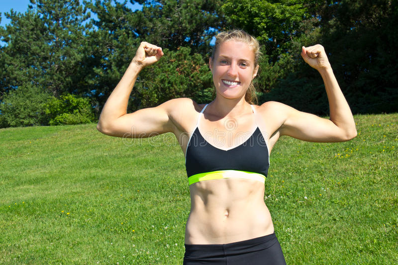 Download Fit, Athletic Woman Flexing Her Muscles Stock Photo - Image: 34930276