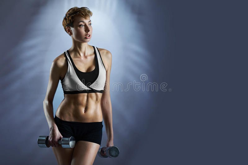 Fit attractive woman wearing sportswear royalty free stock photography