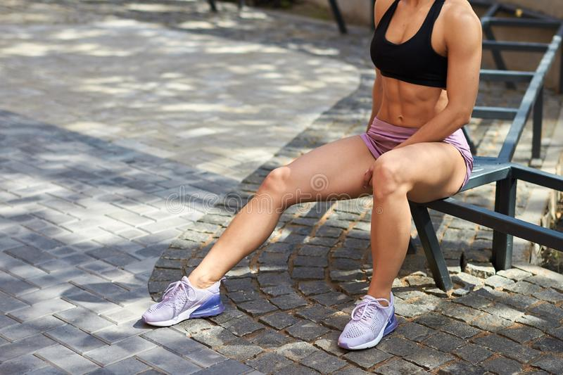 Fit awesome well-built girl having a rest after training royalty free stock photo