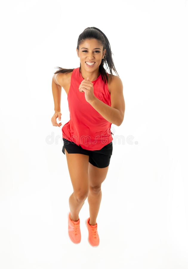Fit beautiful and happy runner woman in sportswear running and training hard stock photo