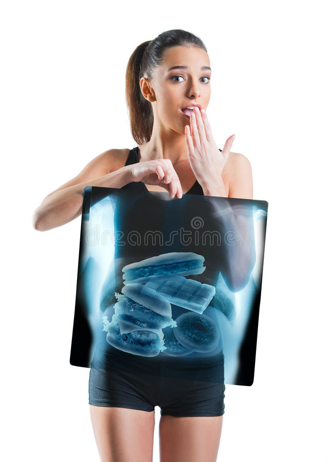 Fit, beautiful woman holding an x-ray of stomach royalty free stock images