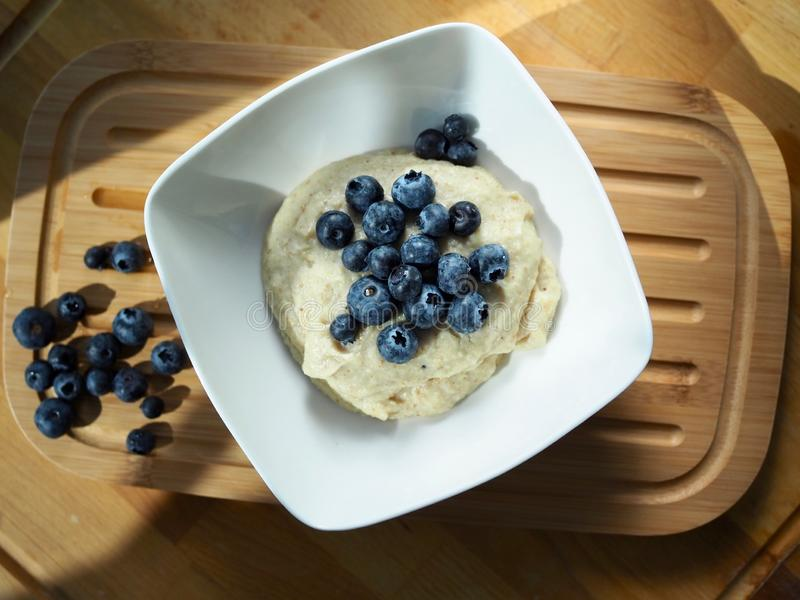 Fit breakfast millet with blueberries royalty free stock photos