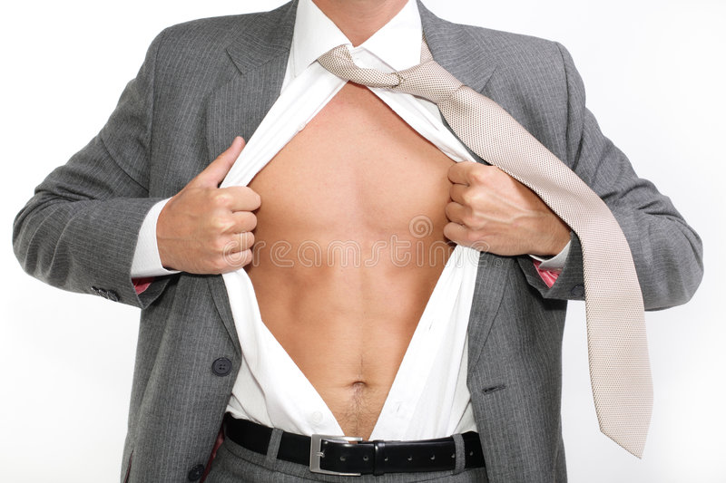 Fit for business. Young businessman dressed in suit, shirt and tie pulling his shirt open revealing well-built torso stock image