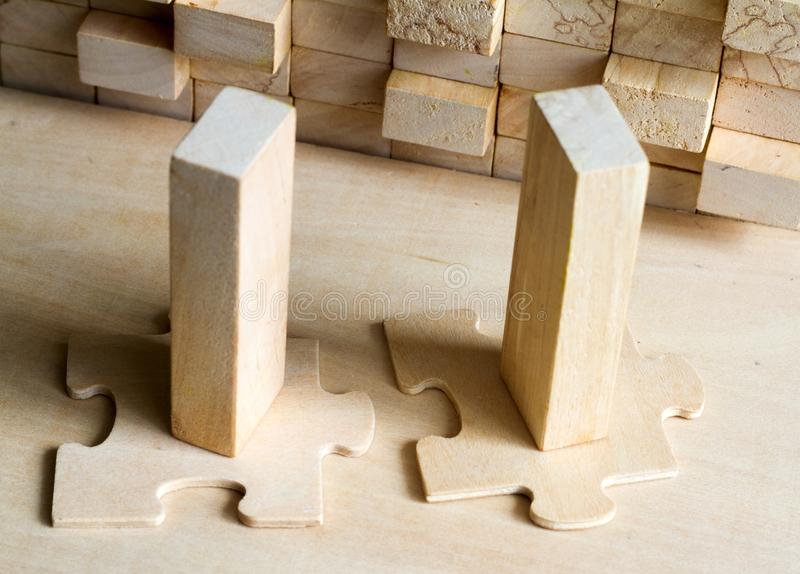 Fit in business concept with team puzzle and block. Abstract royalty free stock image