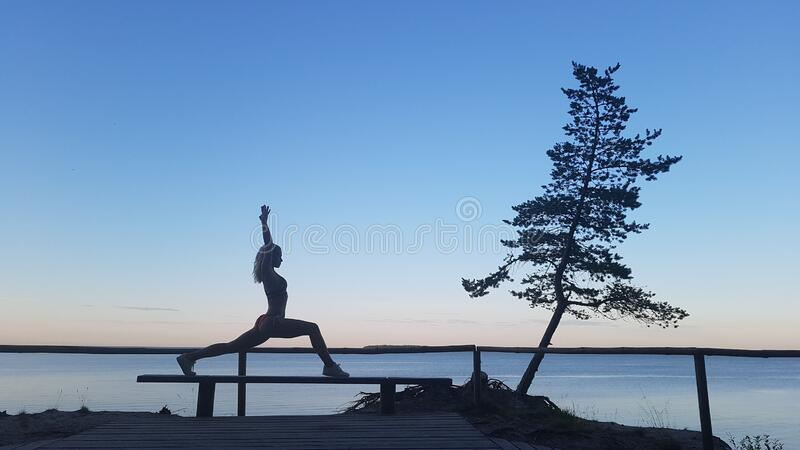 Fit caucasian woman practicing yoga outside royalty free stock images