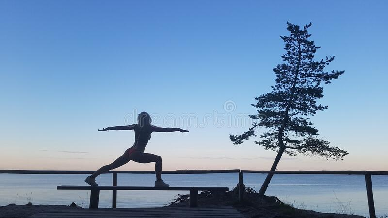 Fit caucasian woman practicing yoga outside royalty free stock photo
