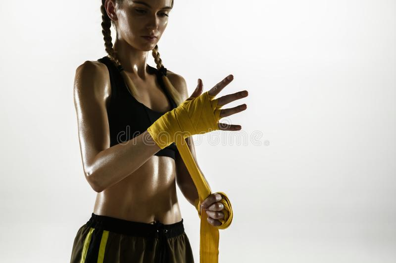 Fit caucasian woman in sportswear boxing isolated on white studio background. Novice female caucasian boxer preparing for working out and training. Sport stock image
