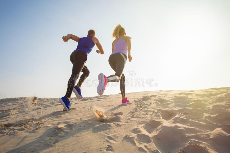 Couple during endurance training outdoors stock photo