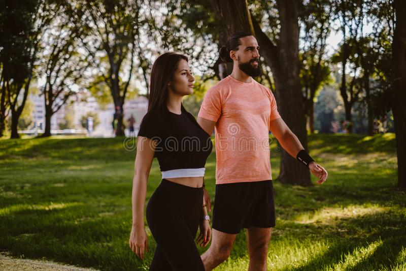 Fit couple recreationally walking in the park stock photo