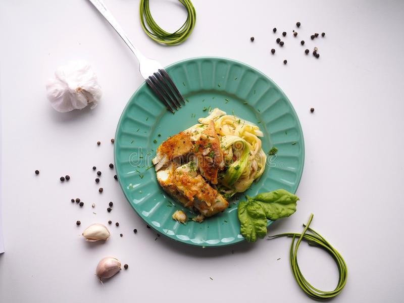 Fit dinner cod on zucchini spaghetti , delicious and easy to make, healthy dish stock photos