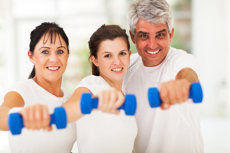 Fit family dumbbells stock images