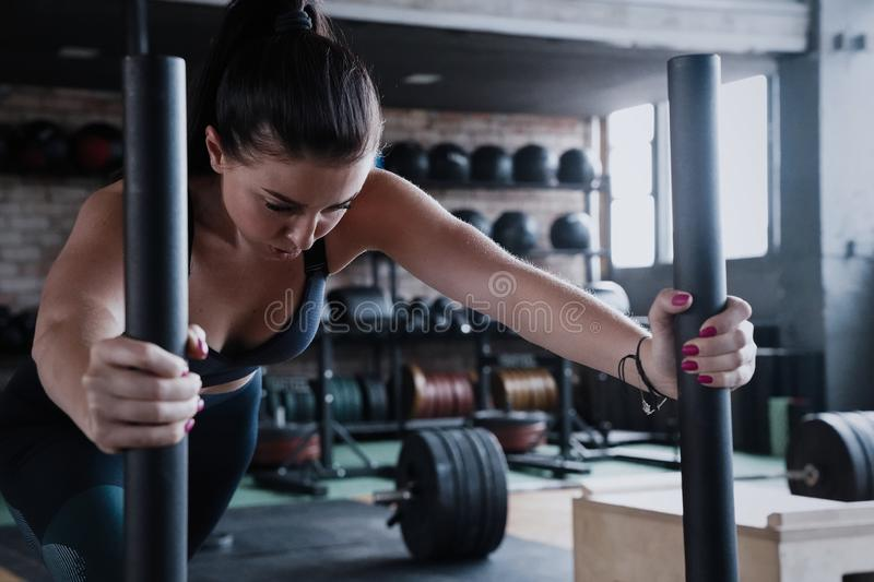 Fit female athlete working out in the gym. Crossfit woman exercising.  royalty free stock images