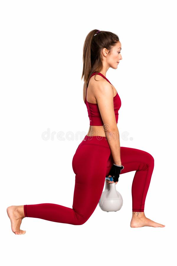 Fit female doing intense core workout with kettlebells - Image royalty free stock image