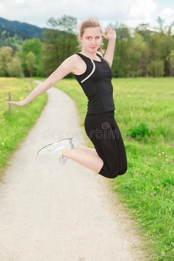 Fit female model jumping stock photo