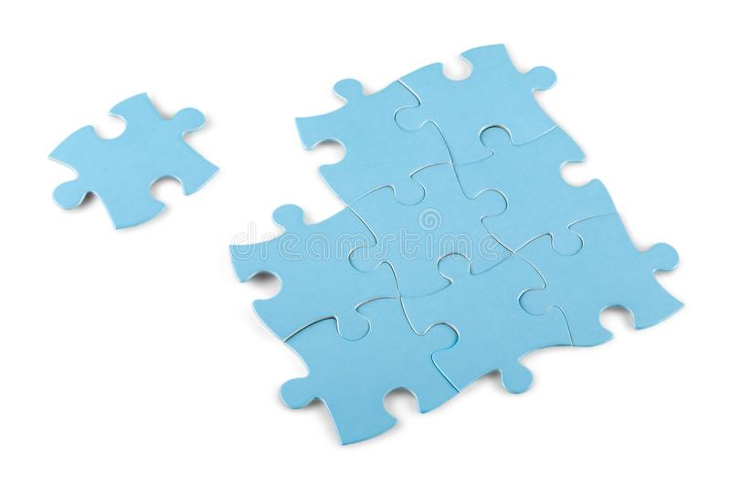 Fitting last puzzle piece on white background royalty free stock images