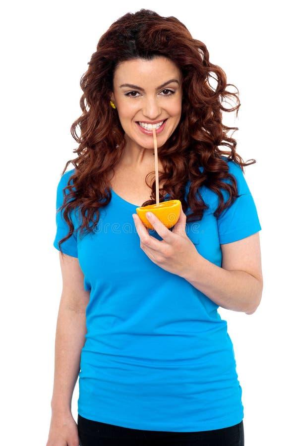 Download Fit Girl Drinking Fresh Orange Juice Stock Photos - Image: 26395363