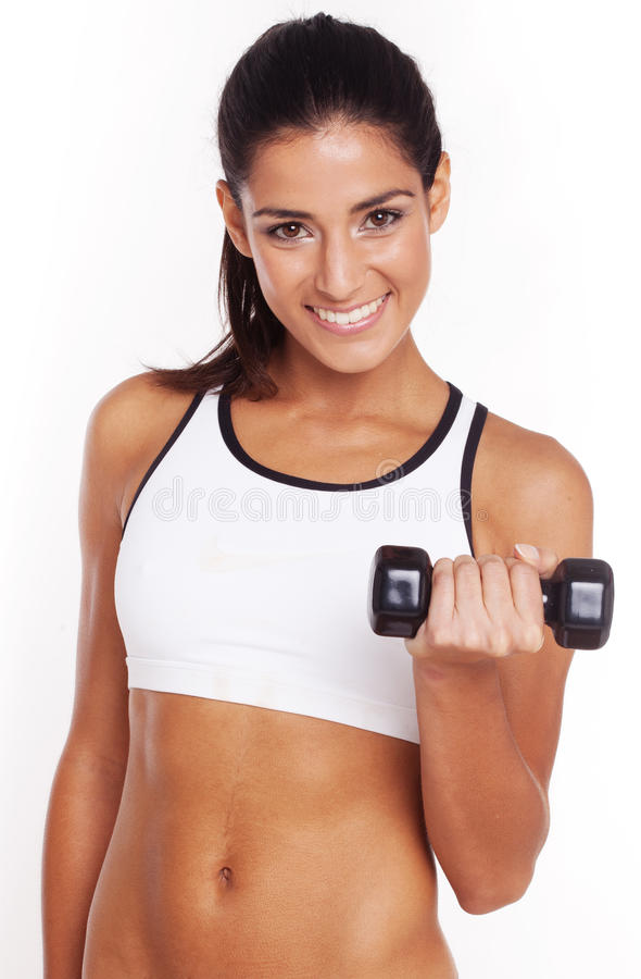 Fit Girl Excercising holding dumbell royalty free stock photo