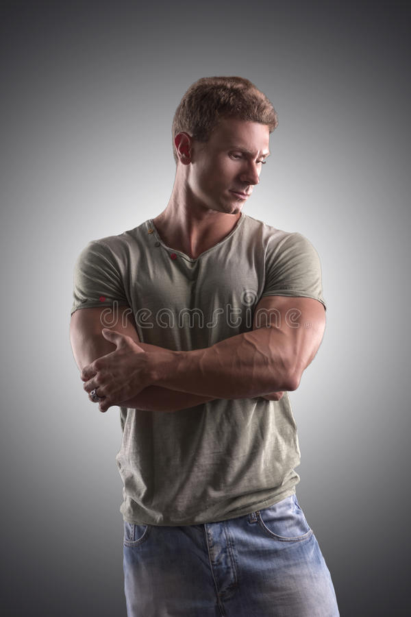 Fit handsome young man standing confident, arms stock images
