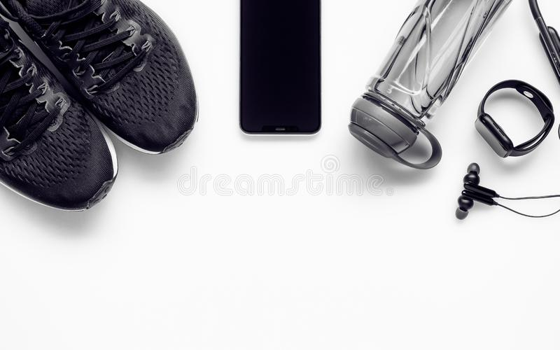 Fit health lifestyle and weight lose diet background concept. Fitness equipment running shoes,water bottle, smartwatch,smartphone royalty free stock photography
