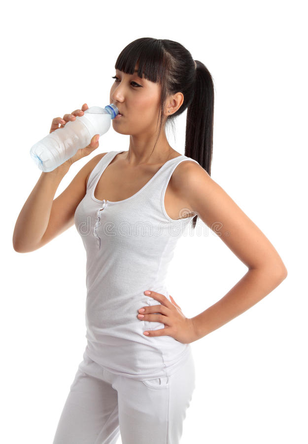 Fit healthy girl drinking water stock image