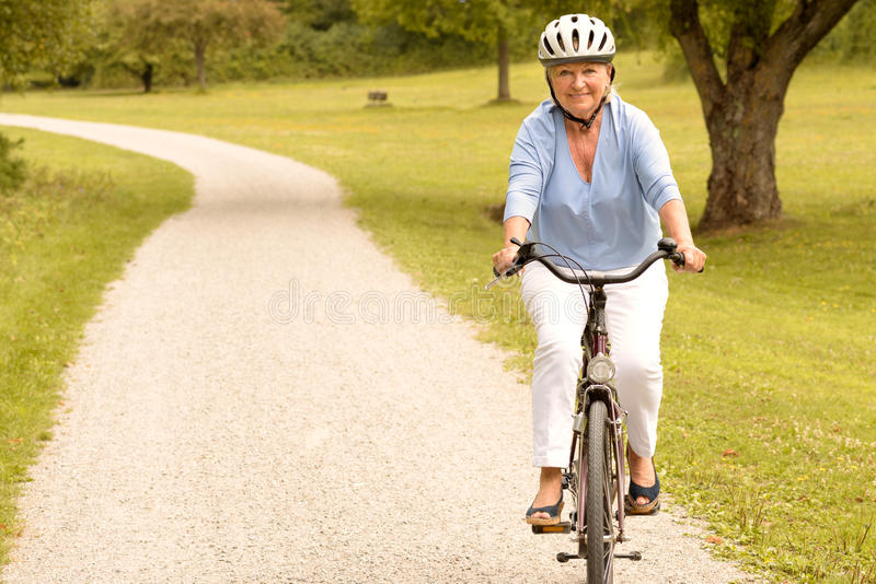 Fit healthy senior lady out cycling royalty free stock photos