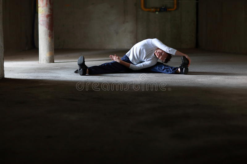 Fit man stretching in dark space royalty free stock images