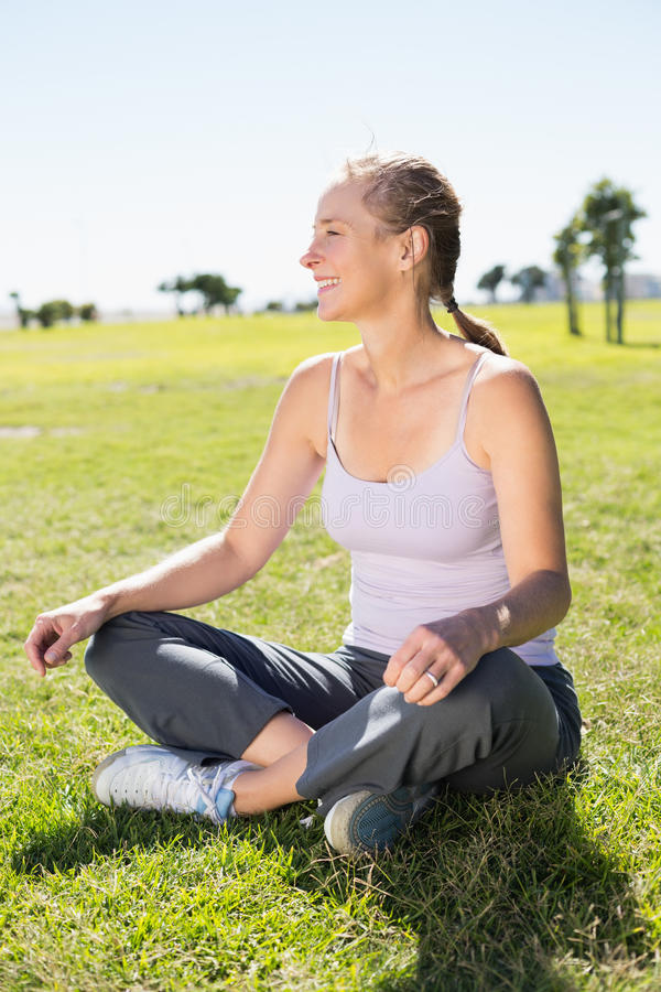 Free Fit Mature Woman Sitting In Lotus Pose On The Grass Royalty Free Stock Images - 43653049