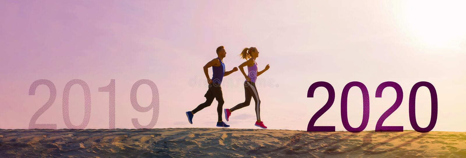 Man and woman running together towards next year stock image