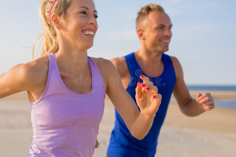 Fit and middle aged couple running outdoor royalty free stock image