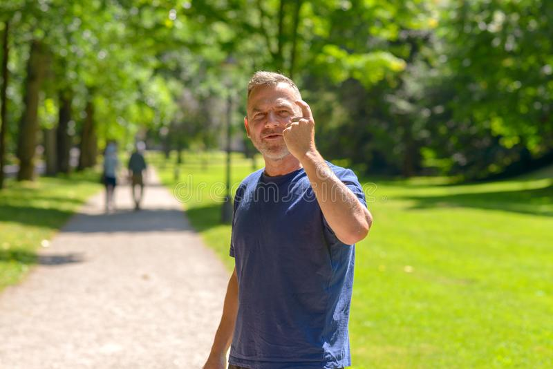 Middle aged man out jogging in a park stock photo